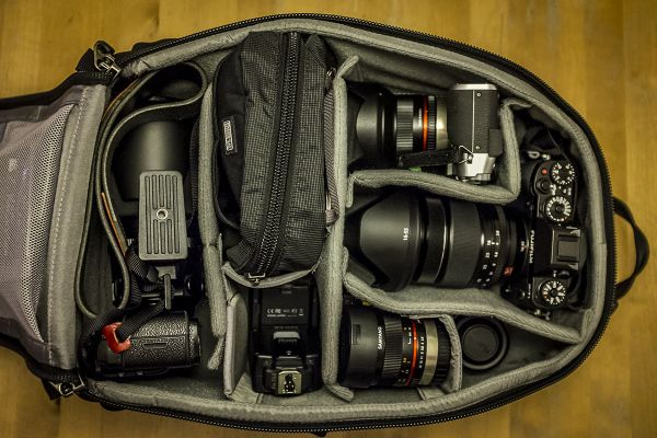 I carry my gear in a Think Tank Urban Approach 15 backpack