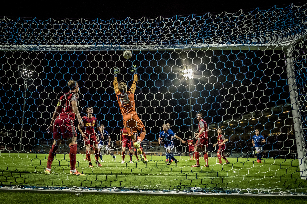 Lyngby vs FCN (Danish ALKA Superliga) This image was taken at the exact same time as the one above. This one I took with my remote camera behind the goal. X-T10 – Samyang 12 mm @ 12 mm – ISO 6400 – f/5.6ish – 1/1000 sec – triggered with a set of Yongnuo RF-603C II
