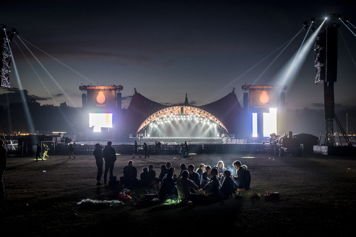 A few of the festival's 32 000 volunteers in front of the iconic Orange Stage. Tomorrow it all goes down.